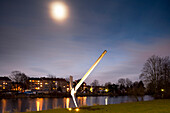 Along the banks of the river Fulda with work of art Spitzhacke by Claes Oldenburg, from documenta 7, Kassel, Hesse, Germany, Europe