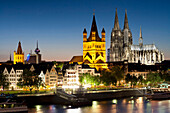 View over river Rhine to old town, Heumarkt with cathedral and Great St. Martin church, Cologne, North Rhine-Westphalia, Germany, Europe