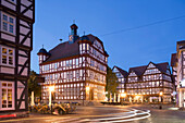 Town hall framed by other timbered houses. The town hall was reconstructed in 1556 after a fire destroyed the former building, Melsungen, Hesse, Germany, Europe