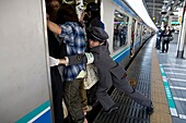 Tokyo's subway system is well developed and organised Some stations nadle more than 1 million passengers a day Most people use public transport to go to work Trains arrive every two minutes