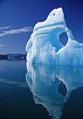 Huge iceberg with hole, LeConte Bay, Southeast, Alaska.
