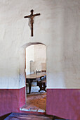 Arched doorway leading to dining room, thick adobe wall at  Mission La Purisima State Historic Park, Lompoc, California, Founded in 1787, the eleventh mission of the twenty-one Spanish Missions established in California