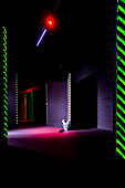 Laser game playing space with narrow corridors and walls, A gaming room with a suit of body armour and a weapon