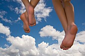 Angel Concept, Feet Floating In Sky Against Clouds