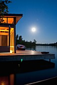 Cottage Exterior In Evening, Lake Of The Woods, Ontario, Canada