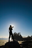 Young Woman Taking Photos, Chesterman's Beach, Tofino, British Columbia, Canada