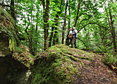 A senior couple hiking in the forest on mount tzouhalem in the cowichan valley, british columbia canada