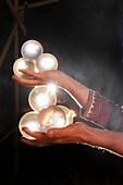 Street artist hold shining balls in his hand, Vienna, Austria