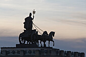 Quadriga on Brunswick Palace in the evening light, reconstruction of the historic facade after damage during world war II and subsequent demolition, the adjoining shopping centre, Schlossarkaden, contains over 150 shops and restaurants, classicism, Brunsw