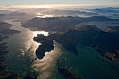 blocked for illustrated books in Germany, Austria, Switzerland: Aerial view of bays and islands in Marlborough Sounds with back light, Marlborough Sounds, South Island, New Zealand