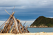 Driftwood tipi, teepee, Awaroa Inlet, Abel Tasman Coastal Track, one of New Zealand's Great Walks in the north-west of South Island, Abel Tasman National Park, South Island, New Zealand
