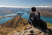 Hiker enjoying the views from Mt Roy over Lake Wanaka, South Island, New Zealand