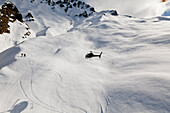 Helicopter landing with winter sportsmen, Skiers and snowboarders, Queenstown, South Island, New Zealand