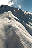Aerial of snowboarders on a mountain slope, South Island, New Zealand