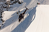 Helicopter landing with winter sportsmen, Skiers and snowboarder, South Island, New Zealand