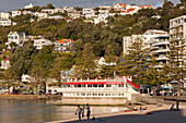 Historic timber houses on the waterfront, cafe on the promenade, Wellington, North Island, New Zealand
