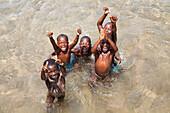 African children bathing, Kalilani village at lake Tanganyika, Mahale Mountains National Park, Tanzania, East Africa, Africa