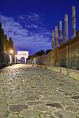 Via sacra leading towards the Arch of Titus, illuminated, Roman Forum, UNESCO World Heritage Site Rome, Rome, Latium, Lazio, Italy