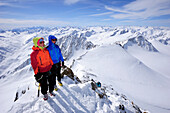 Two backcountry skiers ascending to Wildspitze, Oetztal Alps, Tyrol, Austria