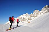 Two backcountry skiers ascending to hut Gruttenhuette, Kaiser-Express, Rote-Rinn-Scharte, Wilder Kaiser, Kaiser mountain range, Tyrol, Austria