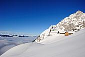 Hut Gruttenhuette in snow, Wilder Kaiser, Kaiser mountain range, Tyrol, Austria