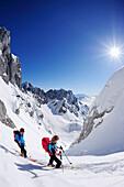 Two backcountry skiers ascending to notch Rote-Rinn-Scharte, Kaiser-Express, Rote-Rinn-Scharte, Wilder Kaiser, Kaiser mountain range, Tyrol, Austria