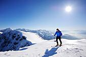 Backcountry skier ascending to Pyramidenspitze, Kaiser-Express, Zahmer Kaiser, Kaiser mountain range, Tyrol, Austria