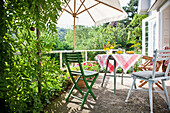 Laid table with breakfst, terrace in the garden, Vienna, Austria