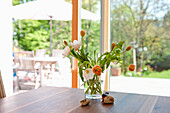 Flowers in a vase, living room vith the view to the garden, spring, Styria, Austria