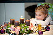 Girl  looking at an Advent wreath, Styria, Austria