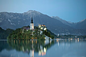 View at St Mary Church at tiny island of Lake Bled at dusk light,  Julian Alps, Gorenjska, Slovenia