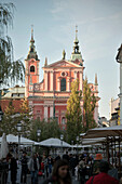 View at Franciscan church of the annunciation, lively inner city impression of capital Ljubljana, Slovenia