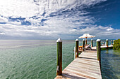 Landing stage with tourists sunbathing, Little Palm Island Resort, Florida Keys, USA