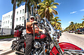 Senior adult on a Harley Davidson motorcycle on Collins Avenue, Art Deco District, South Beach, Miami, Florida, USA