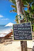 Board with weather forecast of the day, Little Palm Island Resort, Florida Keys, USA