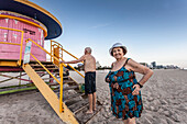 Senior couple at Lifeguard Hut, South Beach, Miami, Florida, USA