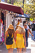 Two young women shopping on Duval Street, Key West, Florida Keys, Florida, USA