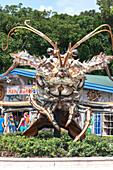 Giant spiny lobster marks the entrance to the artisan village The Rain Barrel, Islamorada, Florida Keys, Florida, USA