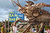 Giant spiny lobster marks the entrance to artisan village The Rain Barrel, Islamorada, Florida Keys, Florida, USA