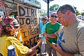 Standup Comedian telling jokes for money, Duval Street, Key West, Florida Keys, Florida, USA