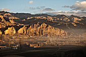 Panoramic view of Bamiyan and the escarpment with hundreds of caves and the niche that contained the Small Buddha statue destroyed by the Taliban in 2001, Bamian Province, Afghanistan