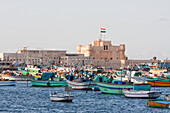 Fishing boats in the Eastern Harbour and Fort Qaitbey, Alexandria, Al Iskandarīyah, Egypt