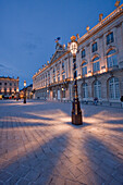 Gilded wrought iron lantern, created by Jean Lamou in front of the Hotel de Ville (City Hall) on Place Stanislas at night, Nancy, France