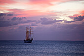 The four-mast barquentine, Esmeralda that is the Chilean Navy Training Ship in Hanga Roa Harbour at dusk, Rapa Nui (Easter Island), Chile