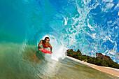 Hawaii, Maui, Makena - Big Beach, Boogie boarder riding barrel of beautiful wave.