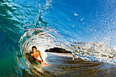Hawaii, Maui, Makena - Big Beach, Boogie boarder riding barrel of beautiful wave, Sunrise light.