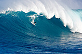 Hawaii, Maui, Peahi (Jaws), Surfer rides a giant wave