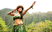 Hawaii, Oahu, Local Hawaiian Female doing a Kahiko Hula Dance.