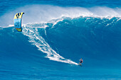 Hawaii, Maui, Peahi, Kitebaorder rides a large wave at Peahi, also know as Jaws. FOR EDITORIAL USE ONLY.