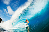 Hawaii, Maui, Kapalua, Professional surfer Albee Layer gets barreled on large wave. FOR EDITORIAL USE ONLY.